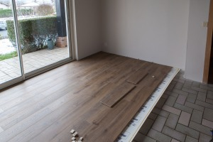 "Laying the floor in the ""Petit Salon"""